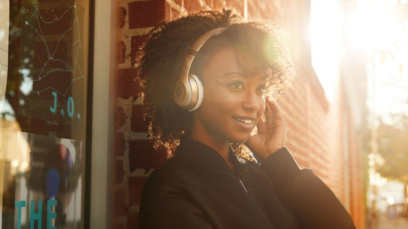 Women wearing Headphones from Beats