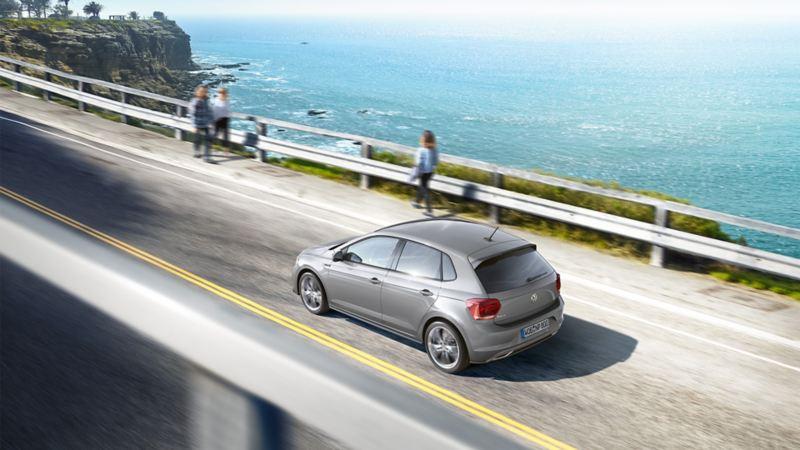 A VW Polo driving over a bridge