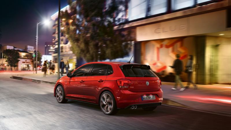 Polo GTI in red Side view of the Polo GTI rear in motion