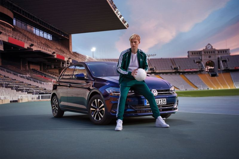 VW Polo-UNITED in stadium, man in front of car, holding ball