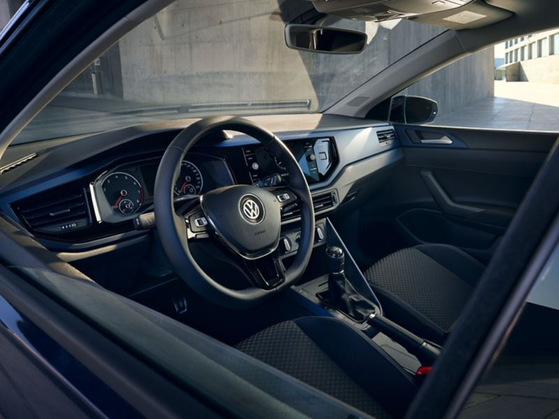 Look into interieur of VW Polo United through drivers window