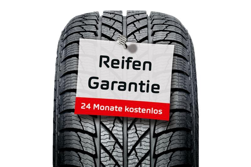 Ein Reifen mit einer Notiz für 24 Monate kostenloser Garantie