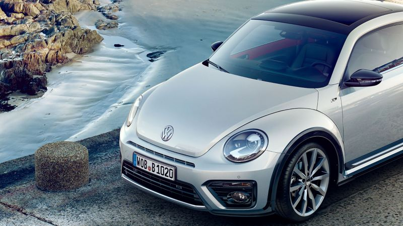 A silver VW New Beetle with Volkswagen Genuine Body Parts