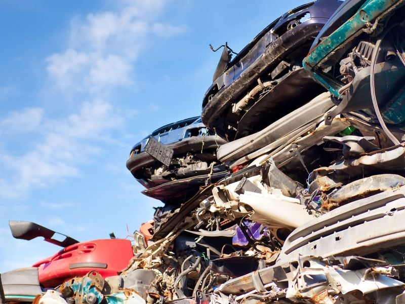 Volkswagen and other scrapped cars after returning, ready for recycling