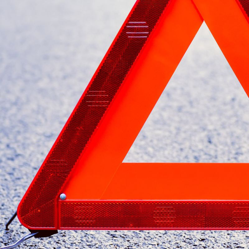 A warning triangle on the road – Volkswagen Roadside Assistance for car accident or breakdown