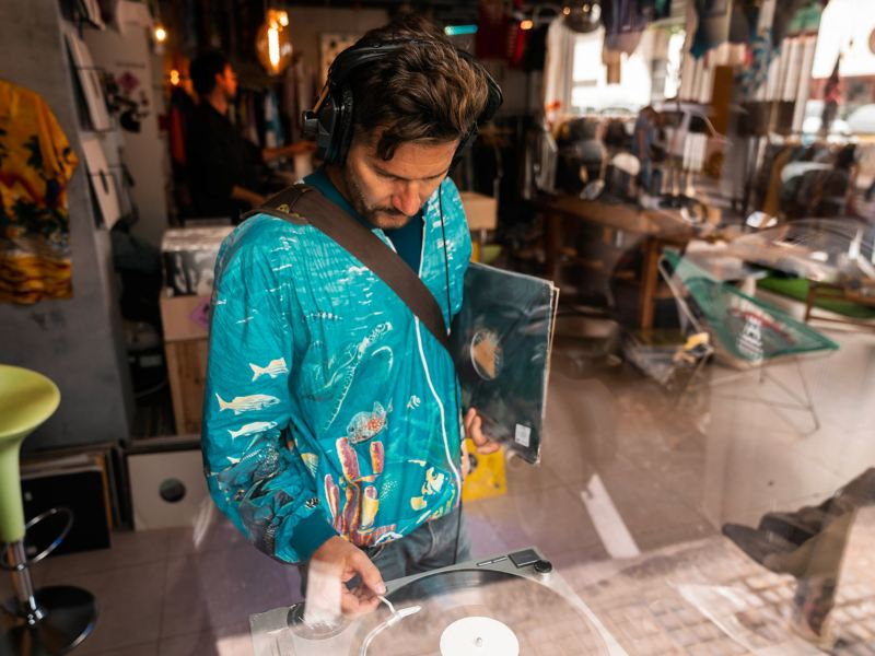 DJ Daniel Klein browses through a record store in Ibiza Town