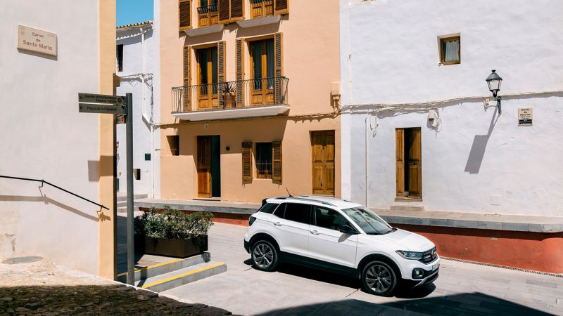 The T-Cross by day in front of colorful Ibiza facades