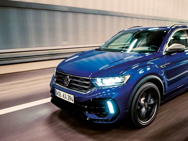 VW T-Roc R driving on a road, focus on the front