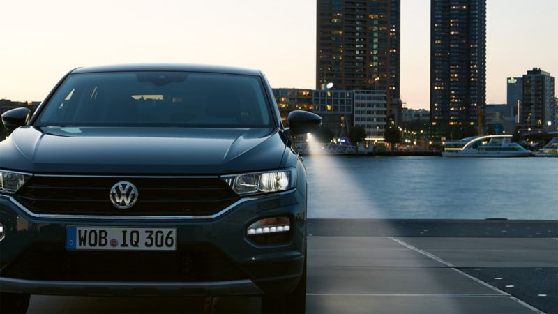 A VW T-Roc viewed from the front at dusk