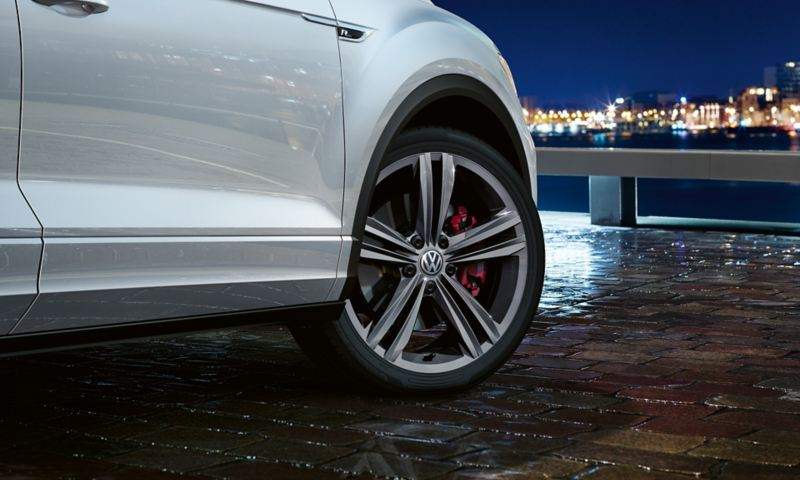 Vehicle detail T-Roc Sport with R-Line Exterior with front wheel and 'Sebring' wheel and red brake calipers