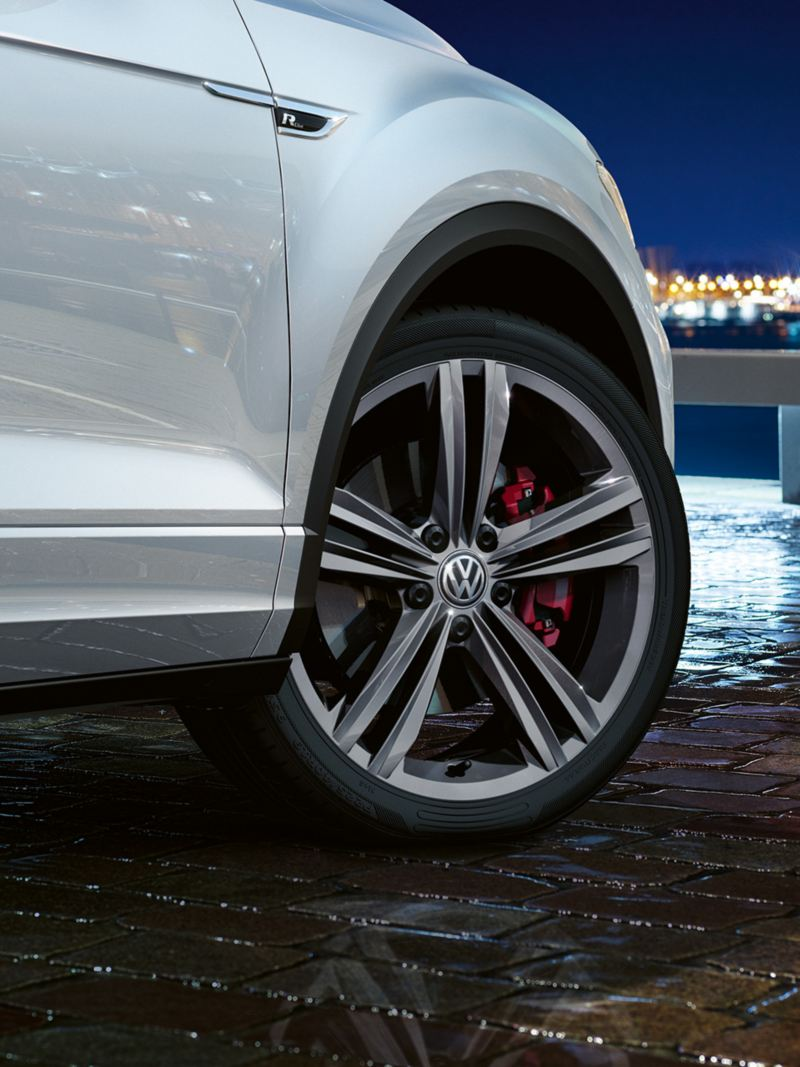 Vehicle detail T-Roc R-Line with front wheel and 'Sebring' wheel and red brake calipers