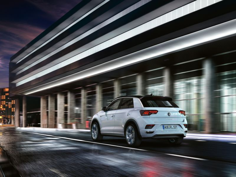 T-Roc with R-Line Exterior driving on the road through the city at night