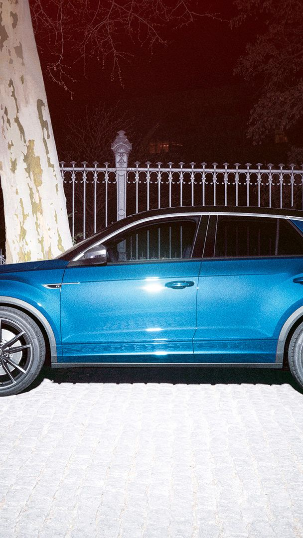 VW T-Roc R parks on a road, view from the side