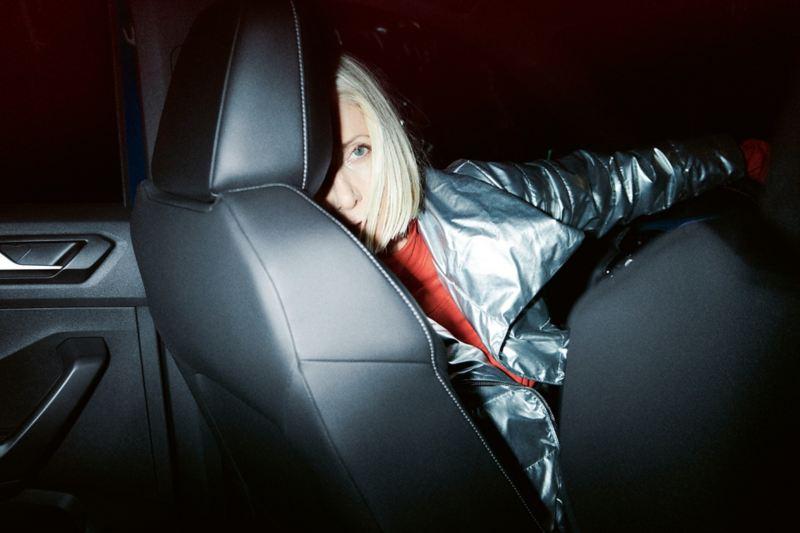 Woman on VW T-Roc R driver seat