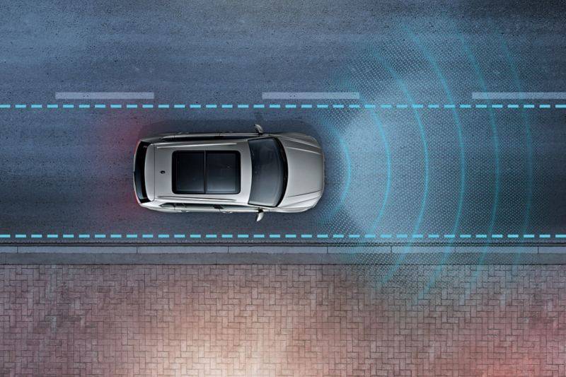 tiguan with Lane Assist drives over road; sensors and road surface optically displayed