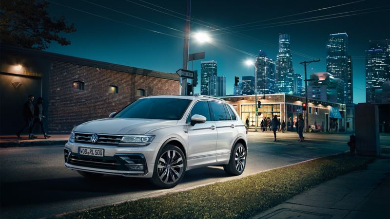 A VW Tiguan R-Line on a road at night