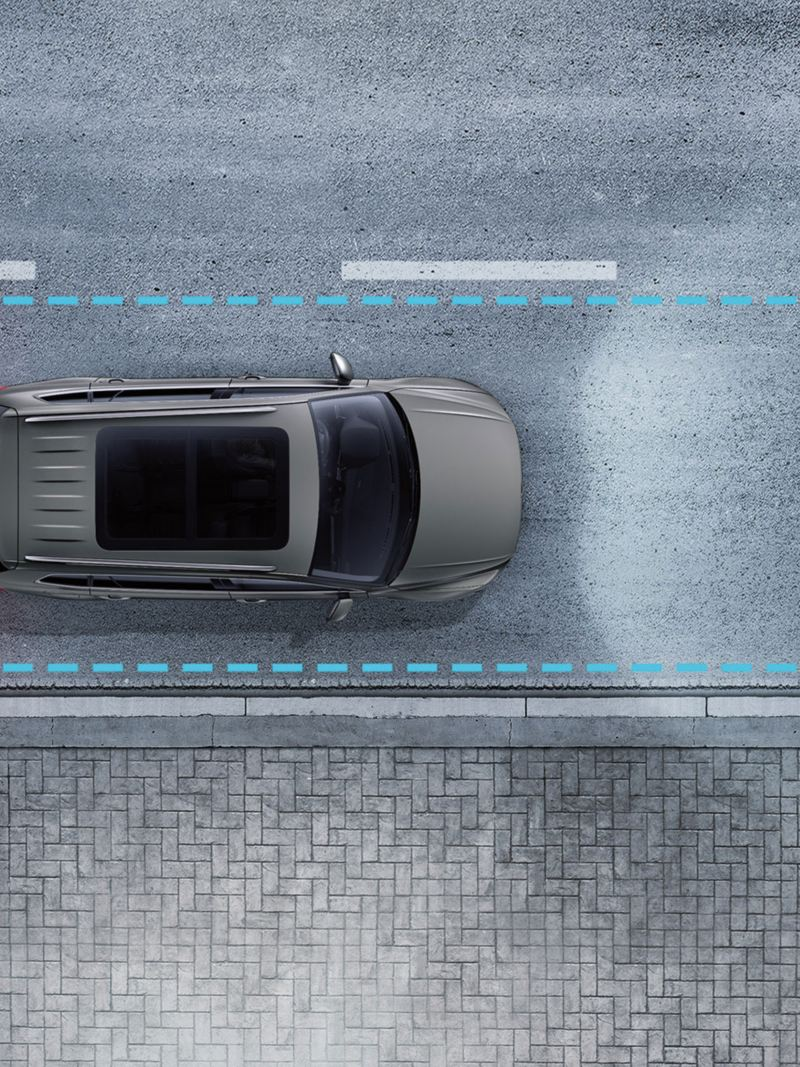Illustration d'un VW Tiguan Allspace en action sur la route, les lignes symbolisent le Lane Assist