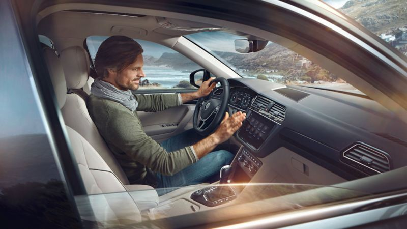 Man sitting inside of a VW Tiguan Allspace, interior