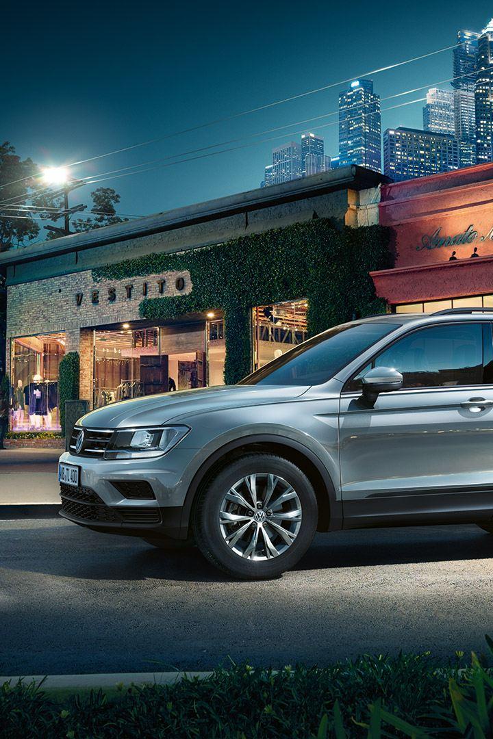 VW Tiguan near storefront