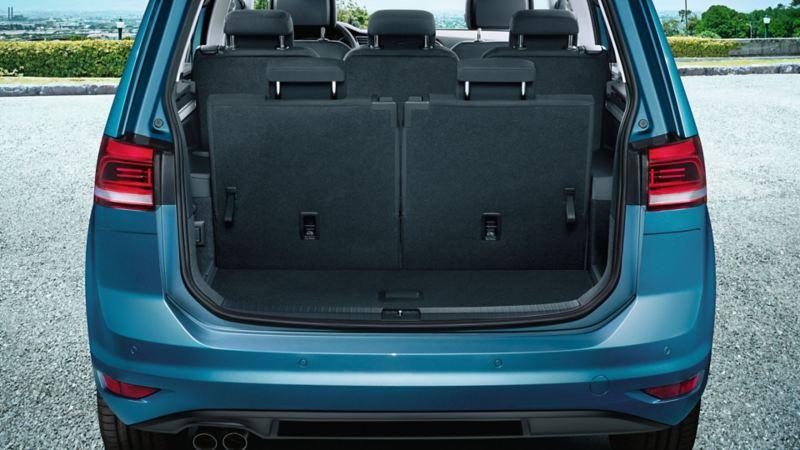 View through open tailgate onto third row of seats of a VW Touran