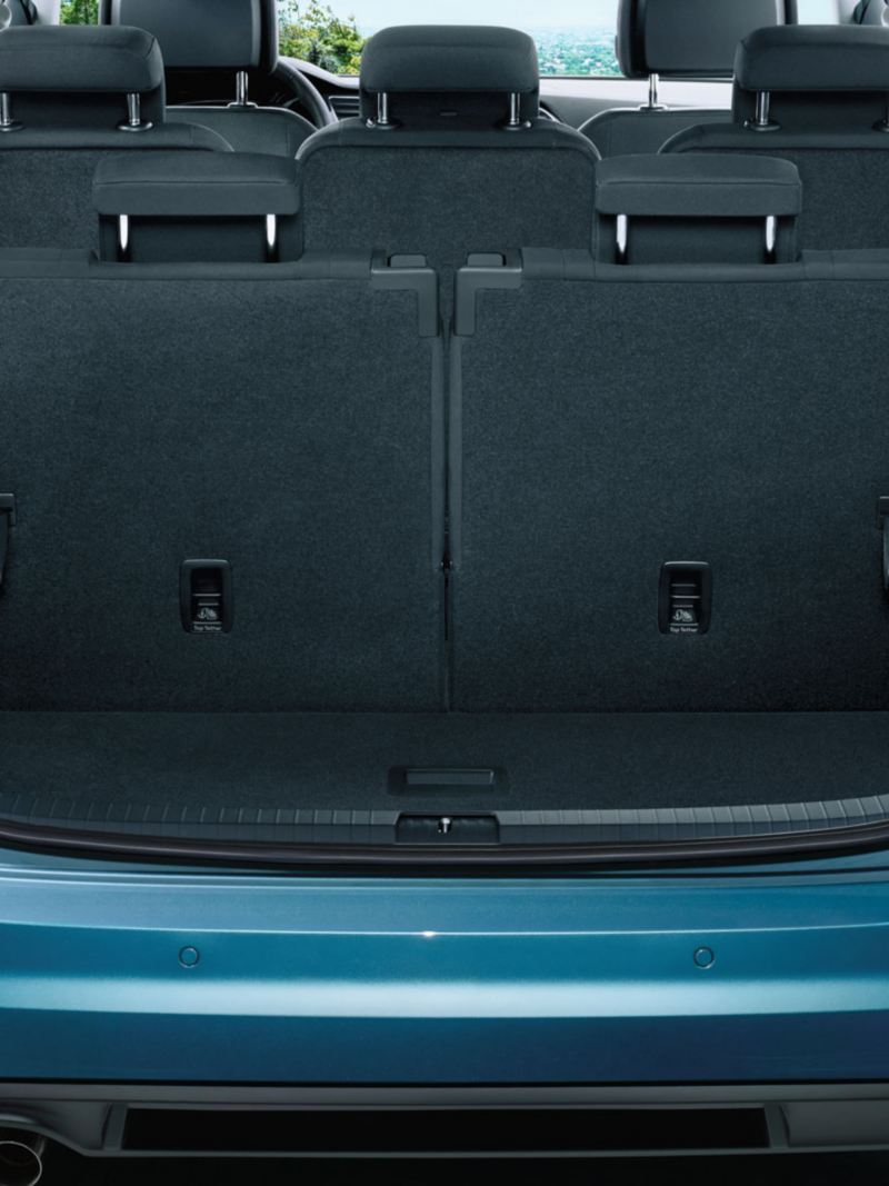 View through open tailgate onto third row of seats of a VW Touran