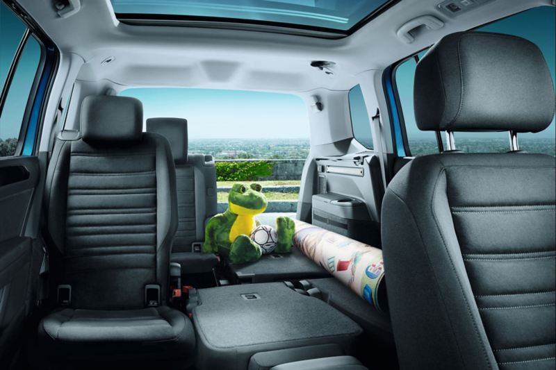 VW Touran with luggage and partly folded second and third row of seats