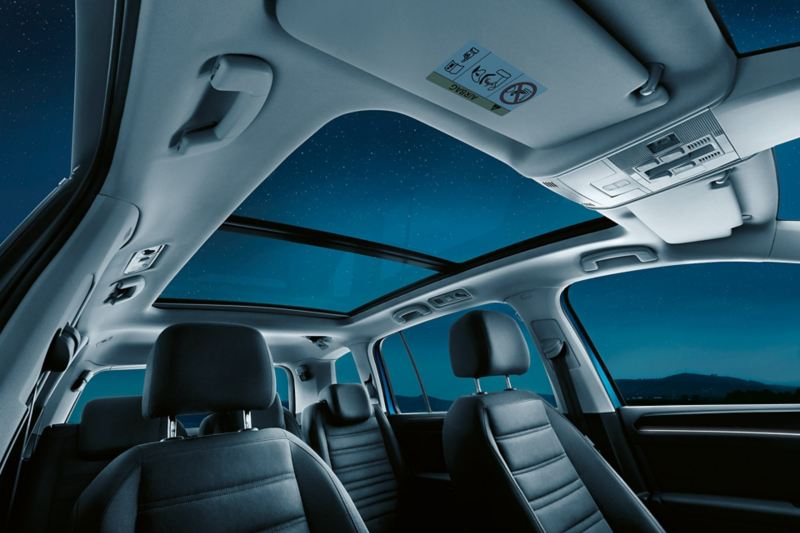 View from the inside to the panorama roof of a VW Touran