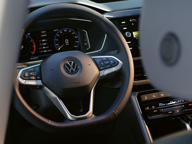 View past steering wheel onto digital instrument panel Active Info Display in VW T-Cross