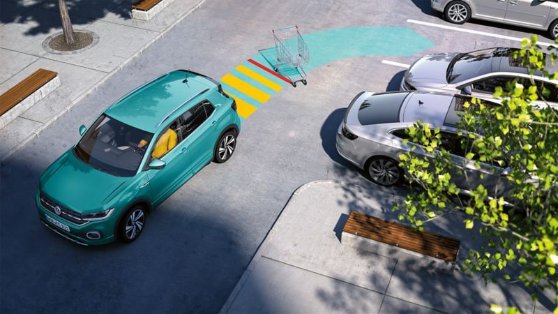 A Volkswagen T-Cross parking with the help of Park Distance Control. The sensor system is shown using an arrow.