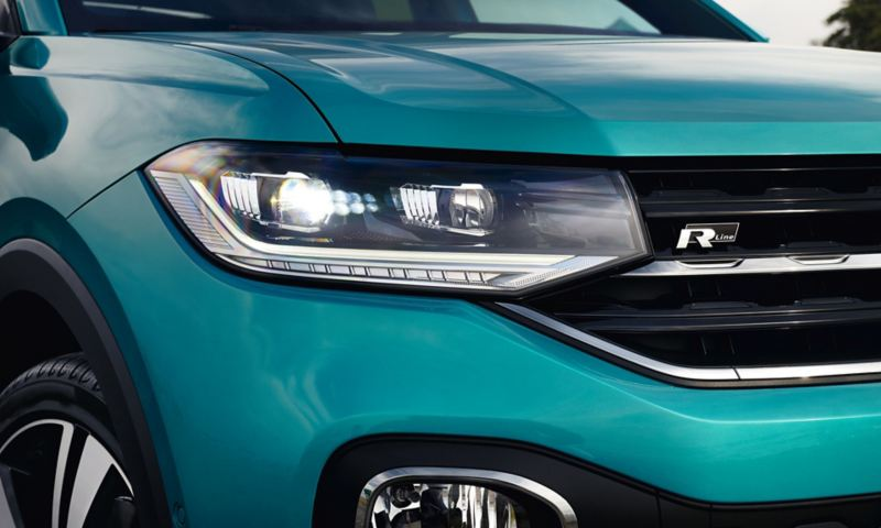 Detail of the front of the new VW T-Cross with headlight and R-Line logo