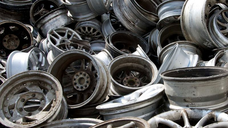 A mountain of several old wheel rims