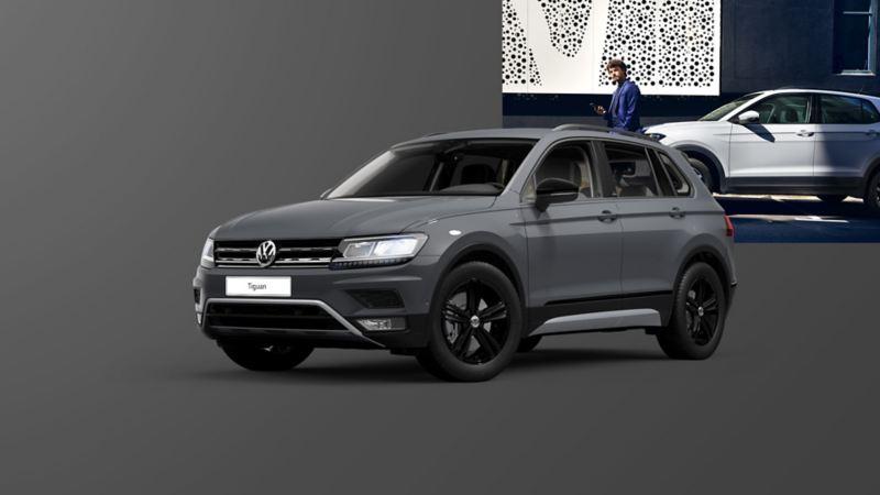 VW Tiguan Offroad stoi obok stromej skały