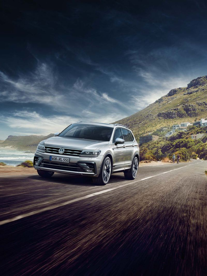 Tiguan Allspace driving through mountains.