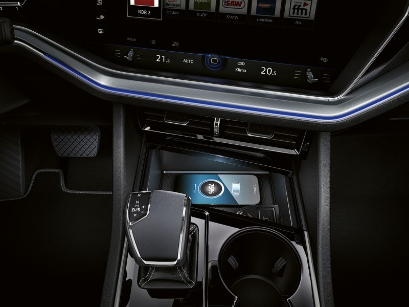 A mobile phone charging wirelessly inside the Volkswagen Touareg