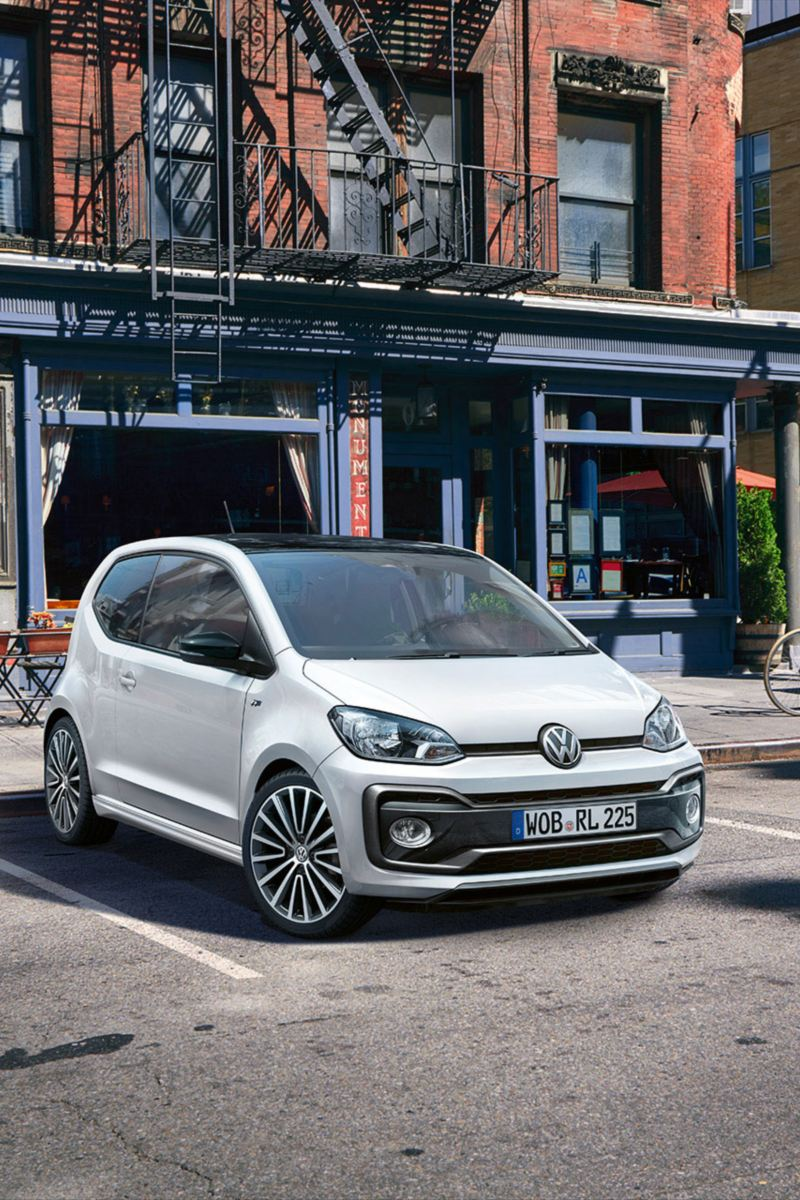 "VW up! with package R-Line ""Exterieur"" on a parking lot in front of a house with fire stairs"