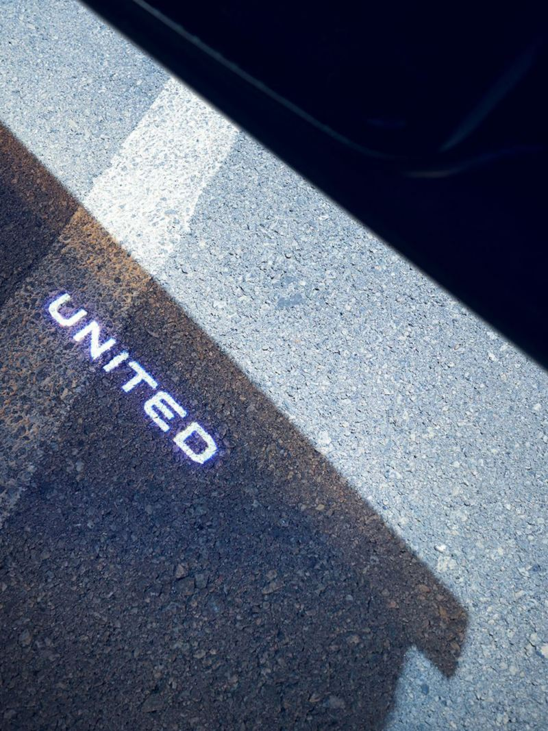 The United badge being projected from a Tiguan