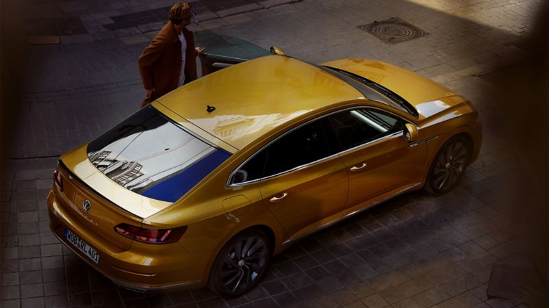 VW Arteon with man at drivers door