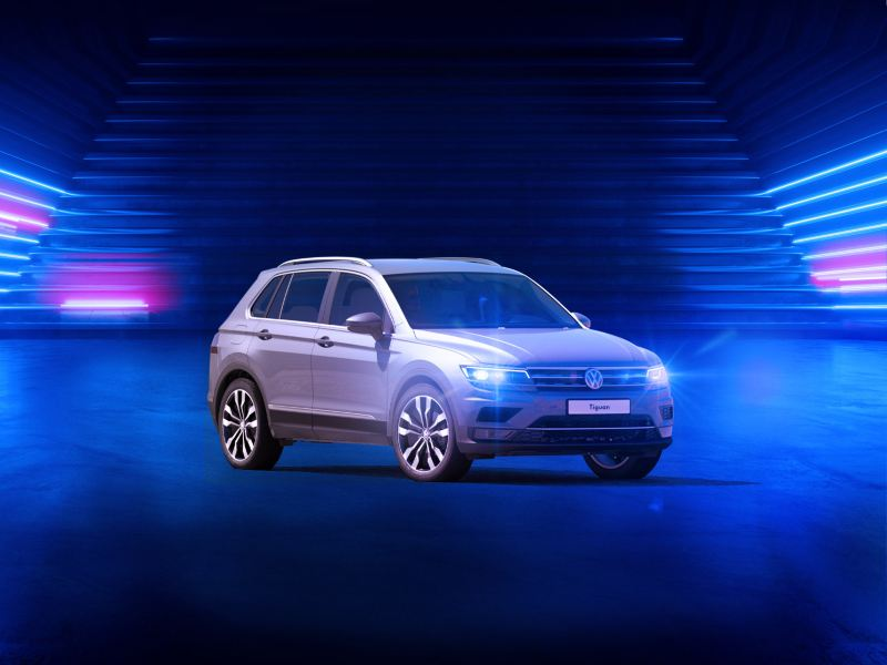 The VW Tiguan parked in a blue room - the Volkswagen Oman Tiguan offer