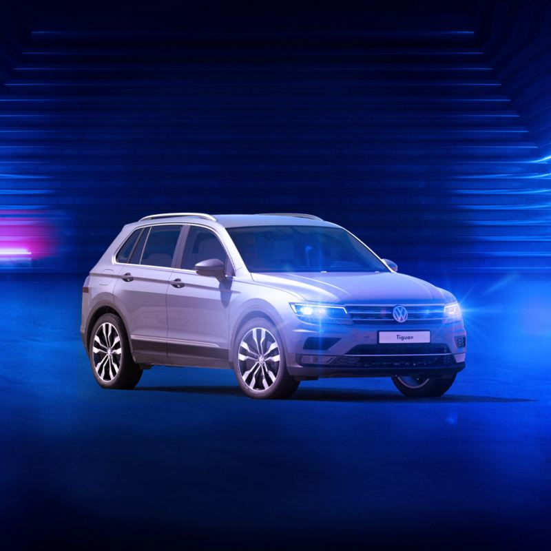 The Volkswagen Oman Tiguan offer - VW Tiguan parked in a neon blue room