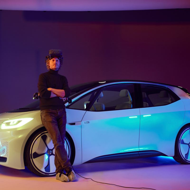 Leo leans against the ID. concept car.