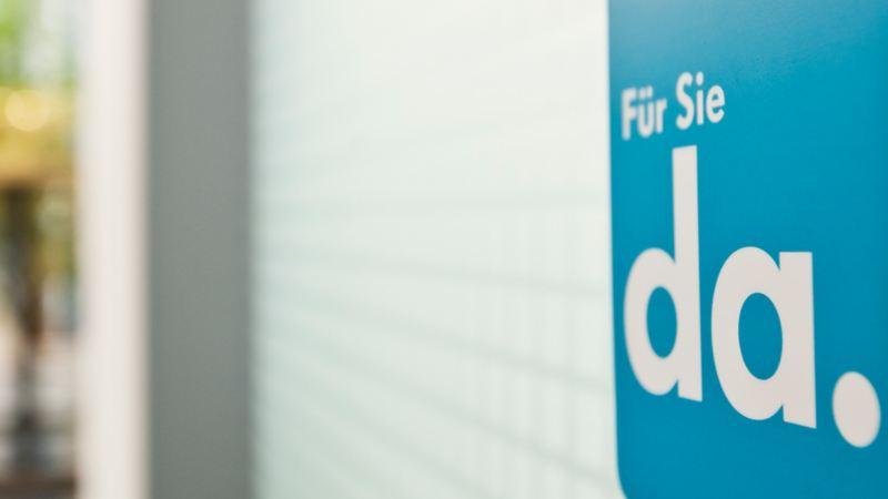 Interior shot with Volkswagen banner against a blurred background