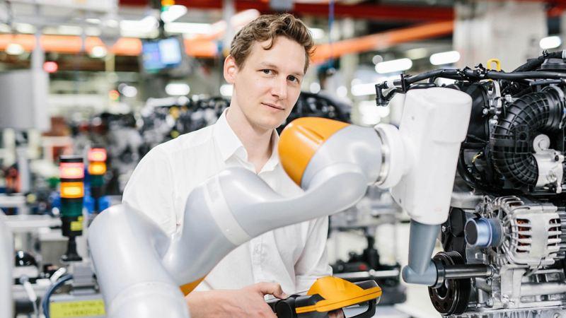 A man working on a robot arm