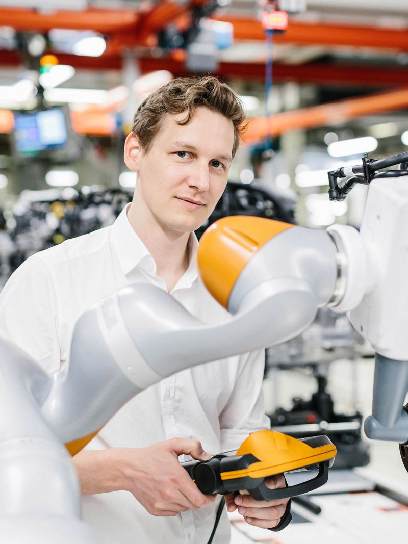 A man working on a robot arm