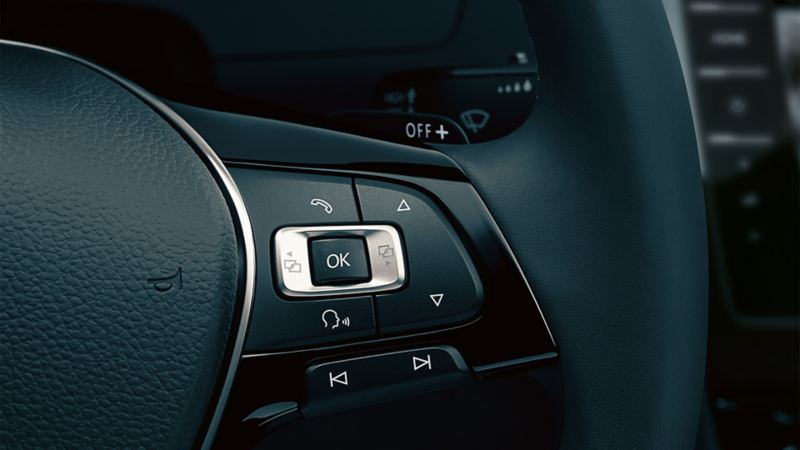 VW Passat steering wheel with focus on voice control
