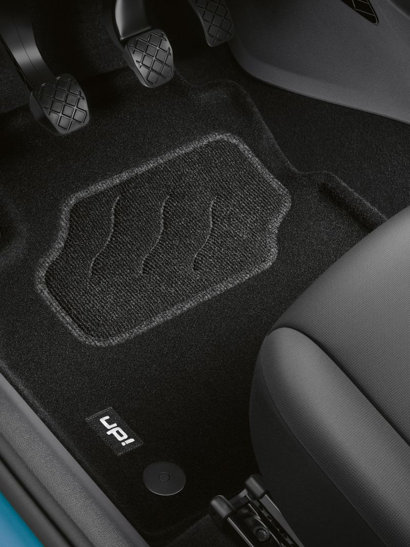 VW Accessories floor mats in the footwell of a blue VW up!