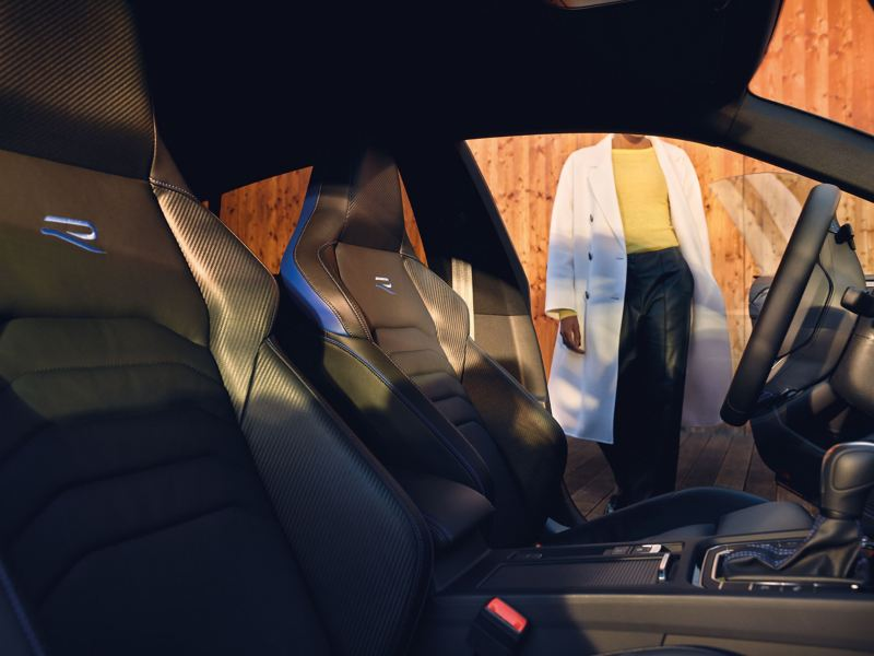 A woman gets into her VW R model with an elegant interior