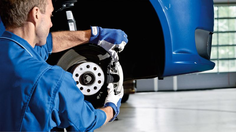 Technician working on van brake disc