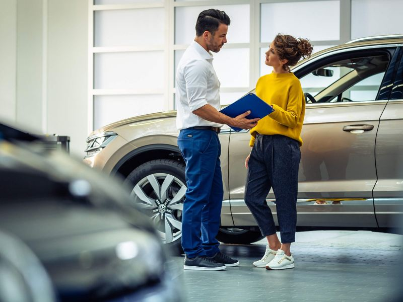 A Volkswagen Service Manager talking to a customer