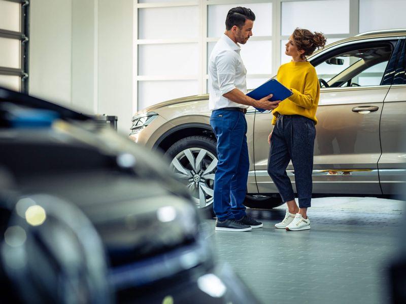 Volkswagen technician with customer