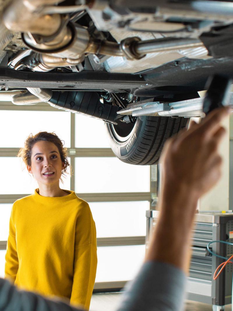 Technician under a Volkswagen car